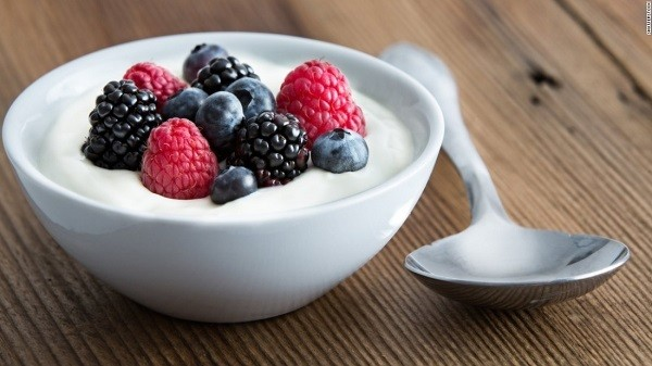 Yogurt in a bowl with berries on it.